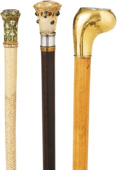 THE DUCHESS OF NEMOURS'S WHIP WITH GOLD, ENAMEL AND AMETHYST HANDLE, AN UMBRELLA WITH SMOKY QUARTZ AND CABOCHON SAPPHIRE HANDLE, AND A CANE WITH GOLD AND ENGRAVED TURQUOISE HANDLE, FRANCE, LATE 19TH CENTURY