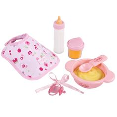 $19.95 Corolle Mon Premier Mealtime Set. Corolles Mon Premier Mealtime Set is the ideal accessory for little mommies ages 18 months and up. This essential feeding set with 6 accessories has everything little ones need to feed their favorite 12-inch baby doll: feeding dish and spoon, bottle, drinking cup, and pacifier plus a bib in a charming bunnies print fabric. Mealtime essential feeding accessories include a charming bunny print bib, bottle, drinking cup, dish and spoon. Pretty, swee