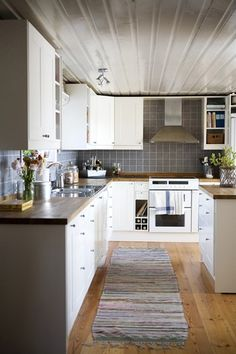 Cabinets, tiles and wooden flooring. all geared to a nice organised small kitchen with ample counter space