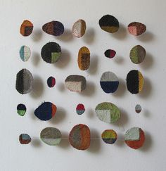"""Marian Bijlenga, 2011, 40 x 40 cm, fabric, machine embroidery.  web site: marianbijlenga.com  """"I see my work as drawing,"""" says Bijlenga. """"I like patterns, and when you work with lines and dots, you see lines and dots everywhere."""" While her early work often alluded to alphabets and calligraphy, she now takes her inspiration from nature: white fungal dots on tree trunks, the curve of eucalyptus leaves, swirling water eddies (article, Fiberarts Magazine)"""