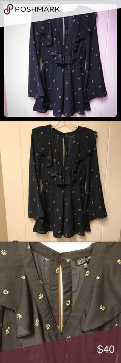 Topshop Floral Romper with Bell Sleeves 6 Navy blue and tan floral print romper with ruffle neckline, slit open back style, and bell sleeves.  Has back zipper.  Very good preowned condition.  Please note this is a romper, not a dress - I could not find a subcategory for rompers, lol! Topshop Pants Jumpsuits & Rompers
