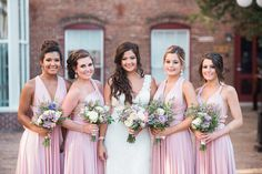 Bride and Bridesmaids Wedding Portrait in Blush Bridesmaids Dresses and Lace, White Wedding Dress and Purple and Ivory Floral Wedding Bouquets | Tampa Wedding Florist Andrea Layne Floral Design