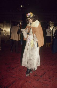 Dame Rollerena, who can be seen skating the streets of New York when she's not at   Studio 54, is shown at the club with her magic wand, 1977. (AP Photo)
