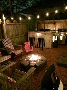 Intimate Backyard Fire Pit Area - I love the intimate nature of this yard space which has all the ingredients for a great family evening - fire pit and seating, barbecue and home bar.