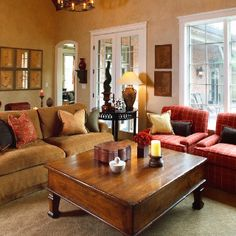 family room- notice the chairs next to each other and the large coffee table. Very cozy and home-ie like
