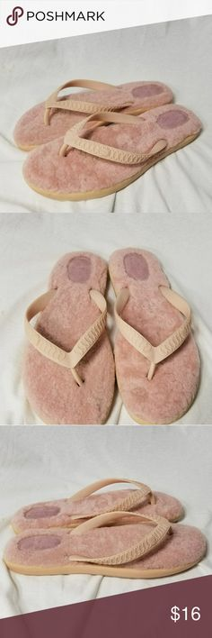 "UGG Sz 10 Womens Pink Fur with Suede Sole Brand:  Ugg  Item: Ladies Size 10W Light Pink lined With Suede Heels *They are Thong Style Flip Flops Sandal*The Strap for Your Feet Has a Pretty Desifn and Says Ugg on the Outside  *Interior of Staps say 'Ugg"" on one Side & 10W on the inner side *The Bottom Soles are say 'Ugg Australia' on the bottoms *Excellent Pre-Loved Condition  *no trades, offers via offer button only* UGG Shoes Sandals"