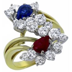0.95ct Pear Shape Sapphire 0.65ct Pear Shape Ruby 2.85ctRoudn Cut Diamond Cluster Gold Ring - See more at: http://www.newyorkestatejewelry.com/rings/0.95ct-sapphire-0.65ct-ruby-2.85ct-diamond-cluster--gold-ring-/22978/1/item#sthash.N0zmJiiV.dpuf