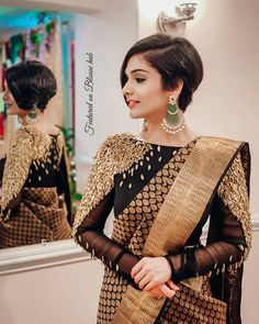 In a black and gold color saree and high neck full sleeve feathery blouse design Blouse Back Neck Designs, Black Blouse Designs, Silk Saree Blouse Designs, Saree Blouse Patterns, Bridal Blouse Designs, Lehenga Blouse, Saree Blouse Models, Dhoti Saree, High Neck Blouse
