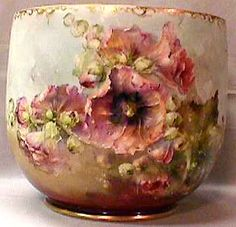 "Franz Bischoff ~ This signed painting of hollyhocks is on a jardiniere which is 11"" high and about 12 1/2"" diameter."