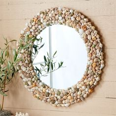 Made a shell wreath years back - pretty simple, and a lot less expensive / Two's Company Coquillage Natural Shell Wall Mirror
