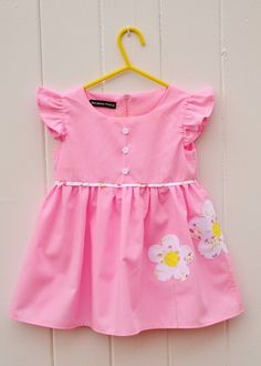 SALE: Was: / NOW: This gorgeous dress would be perfect for any young girl this summer. Made from a classic pink Poly/Cotton & fully lined with the same fabric. The dress has a round neck line & a gathered skirt. Applique Dress, Flower Applique, Ditsy Floral, Floral Fabric, French Seam, Button Flowers, Gathered Skirt, Bodice, Zip Ups