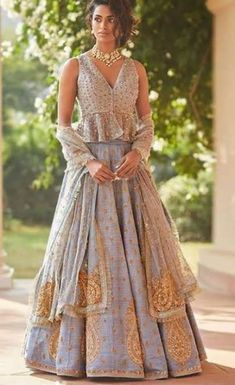 35 Latest Peplum Blouse Designs for Sarees and Lehengas Peplum blouse designs are in trend and this is why they are used by a lot of celebrities. The blouse design is the heavily enticing and with a modern look. In fact, peplum pattern is seen in the le… Choli Designs, Lehenga Designs, Saree Blouse Designs, Indian Fashion Dresses, Indian Designer Outfits, Designer Dresses, Designer Wear, Lehnga Blouse, Peplum Blouse