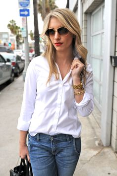 Emily Schuman from Cupcakes and Cashmere displaying the classic white button down and jeans.