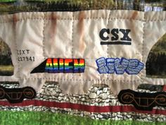 Detail of Rolling Stock Quilt by Faith Agostinone Wilson. CSX Hopper based on actual car.