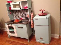 mommo design: IKEA PLAY KITCHEN MAKEOVERS - lovin the idea of painting my ikea kitchen and adding a back panel so kids can't drop stuff behind it! Ikea Kids Kitchen, Diy Play Kitchen, Play Kitchens, Toy Kitchen, Kitchen Sets, Kitchen Hacks, Ideas Habitaciones, Ikea Toys, Childrens Kitchens