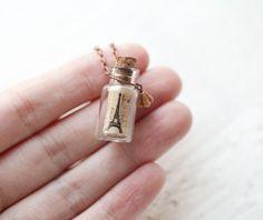 Paris Bottle necklace via Etsy.