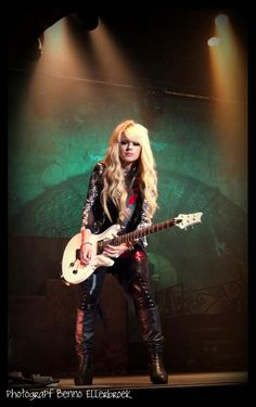 Orianthi - I saw her at Iroquois Amphitheater playing for Alice Cooper. She's all that.