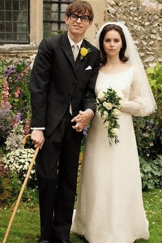 Her dress is so simple, but so flattering. I like the neckline and arms Eddie Redmayne and Felicity Jones as Jane and Stephen Hawking in The Theory of Everything | 23 Incredible Photos Of Actors Vs. The Historical Figures They Played