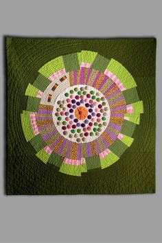 """Floristry: Hothouse Exotic, 44"""" X 44"""", machine pieced and quilted, handbuilt yo-yos, handstitching, commercial cottons. 2011"""