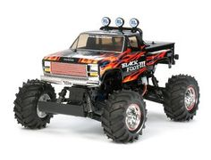This 2WD Tamiya Blackfoot III RC monster truck is the 5th generation vehicle to use the famous Blackfoot name. It features metal-plated parts for the accent parts. The reinforced polycarbonate monocoque frame chassis allows easy access to the main components and makes maintenance of the gearbox a breeze. The Gearbox comes pre-assembled, making it perfect for beginner kit builders. The four-wheel double wishbone suspension offers sure-footed handling over almost any terrain.