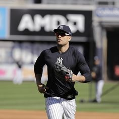New York Yankees star Giancarlo Stanton could be a factor in the American League Championship Series despite a quadriceps injury that has kept him out for the past two games. Giancarlo Stanton, Yankees Fan, New York Yankees, Mlb Rules, Brett Gardner, After Running, Astro