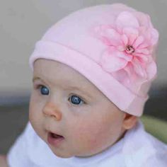 Adorable pink soft baby cotton cap with removable flower accessory.  GigisApparel