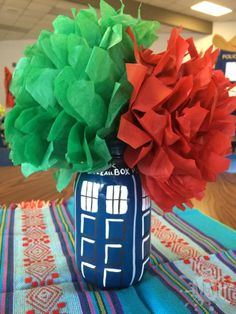 """Tardis mason jar centerpiece with Mexican paper flowers, used at a """"Buenos Tardis: Doctor Who Goes Mexican"""" event. Mason Jar Centerpieces, Centerpiece Ideas, Mason Jars, Doctor Who Baby Shower, Mexican Paper Flowers, Tardis, Murals, Collaboration, Birthday Parties"""