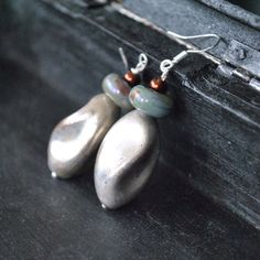 A personal favorite from my Etsy shop https://www.etsy.com/listing/175204242/vintage-silver-bead-earrings-artisan