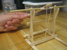 - Activity A photograph of a finished catapult constructed by students with tongue depressors and popsicle sticks.A photograph of a finished catapult constructed by students with tongue depressors and popsicle sticks.