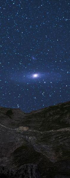 Andromeda Rising over the Alps ~ Although M31, the Andromeda galaxy, appears as a faint and fuzzy blob to the unaided eye, the light you see will be over 2 million years old, making it likely the oldest light you ever will see directly. This image of Andromeda rising above the Italian Alps was captured July 12, 2015. Recent data indicates that our Milky Way Galaxy will collide and coalesce with the slightly larger Andromeda galaxy in a few billion years.