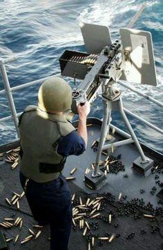 navy: Gunner's Mate First Class Nestor Gonzalez mans the M134 ...