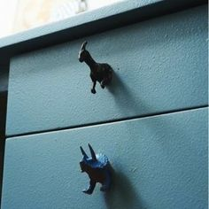 Use brightly painted small toys like these dinosaurs as dresser door or drawer knobs.