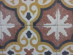 I like the look of terrazzo with cement tile as shown here in a pattern by Original Mission Tile.