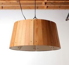 They use recycled plastic and reclaimed wood to create these striking Refold pendant lamps.