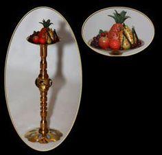 Fruitschaal op voet met in het midden een Pandora kraal.