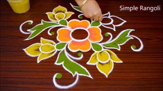 simple rangoli Color Rangoli Design With dots Design Rangoli Designs Simple Diwali, Simple Rangoli Border Designs, Rangoli Simple, Indian Rangoli Designs, Rangoli Designs Latest, Rangoli Designs Flower, Free Hand Rangoli Design, Small Rangoli Design, Rangoli Ideas