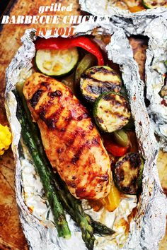 Grilled Barbecue Chicken and Vegetables in Foil - Tender, flavorful chicken covered in sweet barbecue sauce and cooked on the grill inside foil packs with zucchini, bell peppers and asparagus. Grilled Barbecue Chicken and Vegetables in Foil Tender, flavor Foil Pack Meals, Foil Dinners, Easy Bbq Chicken, Easy Chicken Recipes, Grilled Chicken, Healthy Chicken, Chicken Foil Pack, Chicken On The Grill, Barbecued Chicken