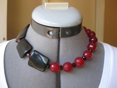 "Item 0003P 17"" Red jade, black acrylic, onyx with silver tone toggle clasp. $30."