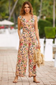 Go bold this spring and beyond in this eye-catching floral jumpsuit with a sleeveless, v-neck bodice topping a ruched waist and sweeping wide legs for dramatic effect. Dresses For Teens, Casual Dresses, Dress Outfits, Fashion Dresses, Jumpsuit Outfit, Dress Shoes, Shoes Heels, Unique Clothes For Women, Jumpsuit Pattern