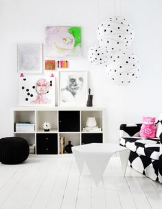 DIY: SPICE UP THE PAPER LAMP SHADE - Black dots give a fresh new look to the white paper lamp shade. Black acrylic paint was used on these rice paper shades.
