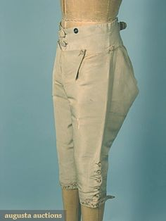 """Gentleman's embroidered silk suit (Breeches), c. 1775.   3-piece pale green faille w/ tambour embroided floral garlands in rose, red & greens on lattice ground, Jacket: Ch 36"""", L 40"""", Breeches: W 28"""", Inseam 18.25"""", Vest L 29"""", (coat faille replaced on 2 top front & 1 top back panel & embroidery appliqued tonew silk faille, coat lining replaced, linen vest back unstitched, wear to silk at cuffs & elsewhere) original linen lining in breeches & vest."""