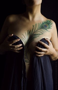 def not there but its one of the better examples of a peacock feather tattoo