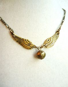 Harry Potter Golden Snitch Necklace by ViperCoraraDesigns on Etsy, $16.00