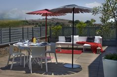 Lovely Futuristic Design from an Italian House: Amusing Terrace In Casa Dartista With Black And Red Parasol Out Door Dinning Furnitures And ...