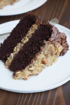 A large slice of German chocolate cake laying sideways on a white plate.