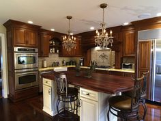 Traditional Kitchen in Wynnewood, PA with a beautiful island with a cherry wood countertop and custom cabinetry. See more at remodelstressfree.com