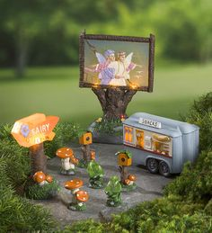 "Miniature Fairy Garden Fly-In Drive-In Theater Set | Miniature Fairy Gardens | Your mini fairy garden will be packed Friday nights with the fairy version of a drive-in theater. The large movie screen with a bark base, ""Fairy Fly-In"" sign and snack truck all light up."