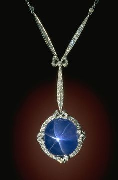 Corundum (variety: Star Sapphire) This art deco-style necklace features a sky blue star sapphire in a platinum setting accented with 126 diamonds. The necklace was designed by Marcus Sapphire Necklace, Sapphire Jewelry, Gemstone Jewelry, Lotus Necklace, Drop Necklace, Flower Necklace, Silver Earrings, Or Antique, Antique Jewelry