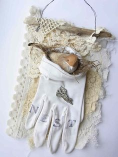 bird in glove. Very pretty.  I like the wire and stick hanger for a piece of lace or fabric to do mixed media stuff.