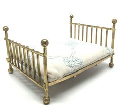 This is a nice queen size brass bed with mattress from the 1970s. Traditional style. 1:12 Scale doll house miniatures. Includes brass bed and quilted mattress.  Great Find! In great condition!  Message me for combined shipping if you are buying multiple items or I can refund shipping overages after items have shipped.  If you are located outside of the US and interested in this item please message me and I will give you a shipping quote. I am also happy to do combined shipping for multiple…